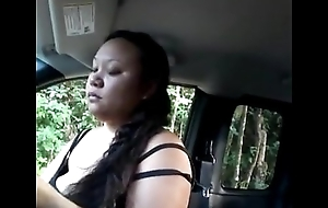 Chubby oriental sucking Hawkshaw in auto