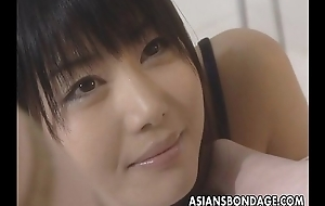 Asian lesbians restriction it into a sexy bdsm session