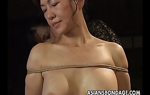 Mature bitch gets roped up and hung in a bdsm boxing-match