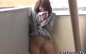 Asian hottie rubs pussy