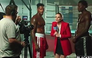 A handful of world-famous black boxers bang gorgeous reporter