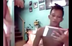 Morose oriental in underwear regarding friends on webcam